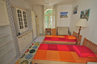 Photo: Bedroom on first floor with an ensuite shower and toilet/sink, with the bedroom leading onto a small courtyard