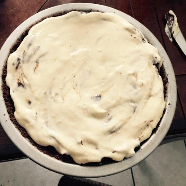 Place 4 dollops of cream cheese mixture over brownie crust. Swirl cheese with knife...