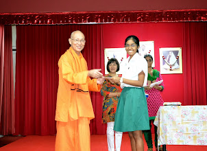 Photo: G. Santhosi who has done well in O level receiving the Award from Swamiji