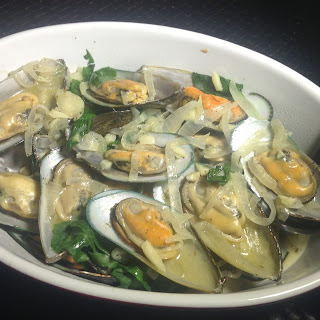 Half Shell Mussels in White Wine and Butter Sauce