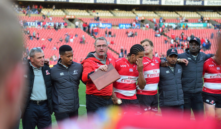 The Emirates Lions head coach Swys de Bruin and his players gather during the Super Rugby semifinals match against the Waratahs at Ellis Park Stadium, Johannesburg on July 28 2018.