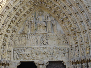Photo: The central area is topped by Jesus and several angels, below which is the Archangel Michael weighing the souls of the resurrected, who have been awakened by the angel's trumpet as shown in the bottom area.