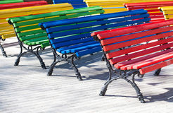 multicolored-wooden-benches-red-green-yellow-colors-difference-conceptual-image-fascia-tile-sunny-day-60579906.jpg