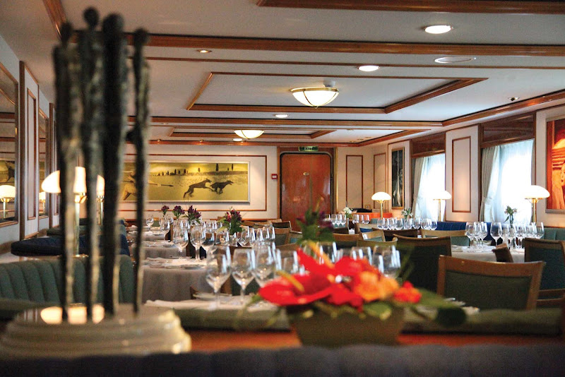 Get recharged for the next day's adventure in National Geographic Orion's dining room on your Lindblad Expeditions trip.
