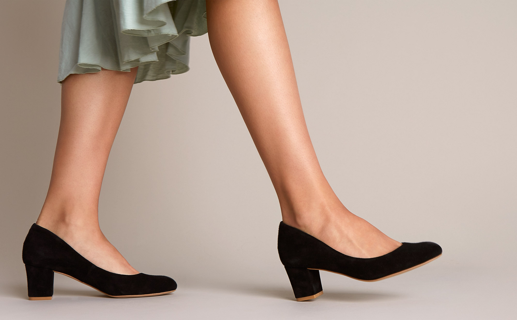 Black suede pumps to wear to the office