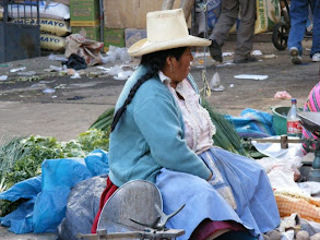 Photo: Lady selling her wares  at the market