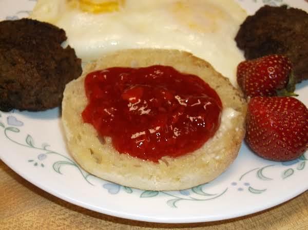 Strawberry Freezer Jam On Buttered English Muffin.