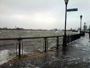 Photo: Member of the public's photograph taken with a camera phone of the East River on the Manhattan side in New York, USA as Hurricane Sandy bore down on the US East Coast, threatening to bring an 11ft (3.4-metre) storm surge to the city.  PRESS ASSOCIATION Photo. Picture date: Monday October 29, 2012. Parts of the US city were evacuated amid fears of flooding and power cuts as the superstorm - predicted to hit land at around 7pm local time - approached. See PA story US Storm. Photo credit should read: Andrea Levine /PA Wire