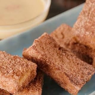 Churros French Toast with White Chocolate-Orange Ganache.