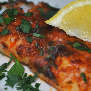 BAKED FISH WITH PAPRIKA LEMON BUTTER.