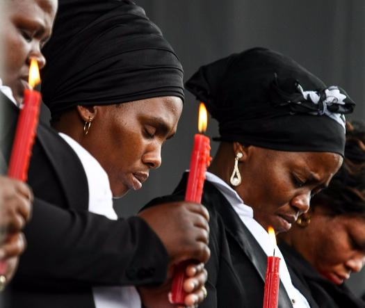 Marikana widows carry candles at an event commemorating the killing of 34 Lonmin mine workers. File Picture: SUNDAY TIMES
