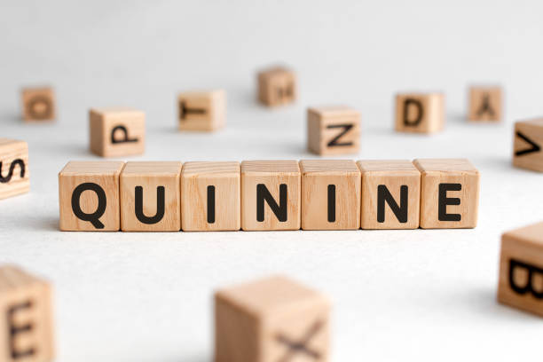 Quinine - words from wooden blocks with letters Quinine - words from wooden blocks with letters, quinine concept, white background quinine stock pictures, royalty-free photos & images