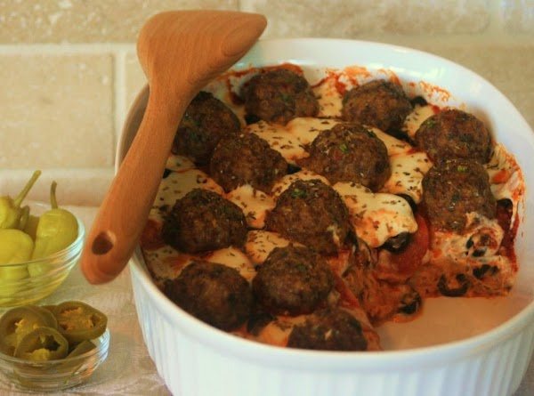 In medium bowl, mix first five ingredients and shape into 16 meatballs. Place onto...