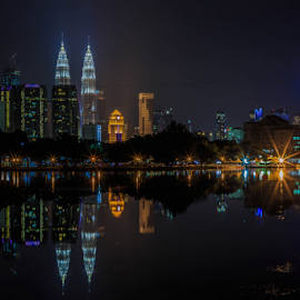 Kuala Lumpur at Night 06 by Daimasala Abdullah - City,  Street & Park  Night ( petronas, city, dusk, financial, scenery, malaysia, twilight, scene, view, road, street, cityscape, avenue, place, highway, landmark, park, twin, architecture, kl, famous, reflection, business, metropolis, lumpur, night, center, mall, malaysian, centre, downtown, water, klcc, kuala, district, evening )