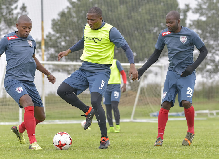 From left to right: Free State Stars defender Tamsanqa Teyise, captain Paulus Masehe and Rooi Mahamutsa during their Nedbank Cup training and media day at the club's Academy in Bethlehem on Tuesday April 18 2018.