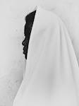 Afrikaan en profiel met witte handdoek over het hoofd