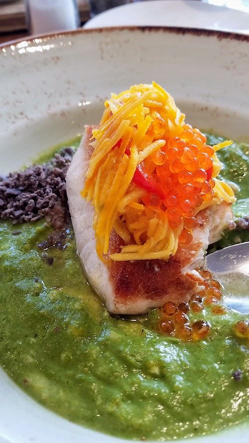 Alto Bajo brunch Plato Fuertes (large plate) of Pescado a la Poblana, a market fish with house pozole grits, poblano cream, conserva, trout roe, and masa crumble