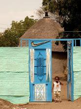 Photo: cute Sudanese girl watching us strangers