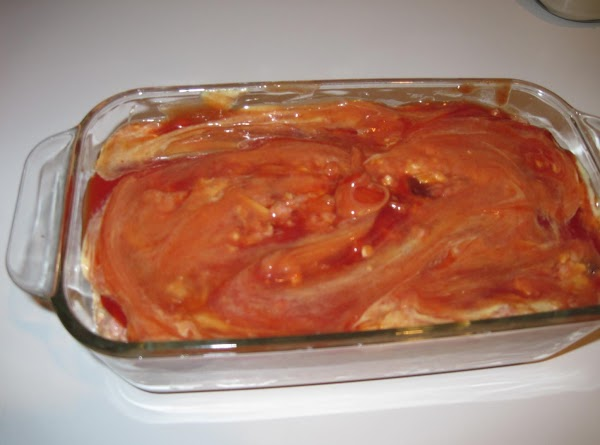 Press meat mixture into a 9 by 5 by 3-inch loaf pan, or shape...