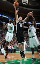 Photo: BOSTON, MA - OCTOBER 16:  Tornike Shengelia #20 of the Brooklyn Nets shoots the ball against Brandon Bass #30 and Jeff Green #8 of the Boston Celtics on October 16, 2012 at the TD Garden in Boston, Massachusetts. NOTE TO USER: User expressly acknowledges and agrees that, by downloading and or using this photograph, User is consenting to the terms and conditions of the Getty Images License Agreement. Mandatory Copyright Notice: Copyright 2012 NBAE  (Photo by Brian Babineau/NBAE via Getty Images)