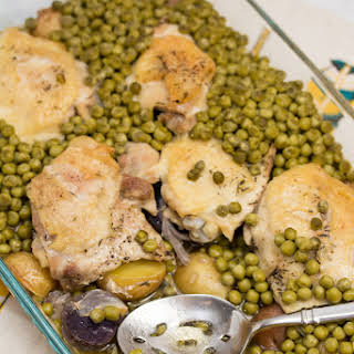 Baked Chicken Thighs with Potatoes and Peas.