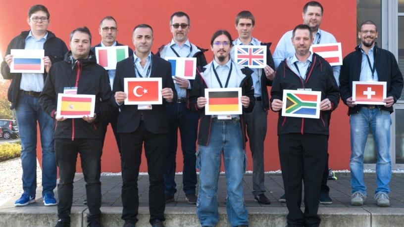 The top 10 service engineers participating in the European leg of the global service awards. Christiaan Pelser from Page Automation, holding the South African flag, was awarded first place.