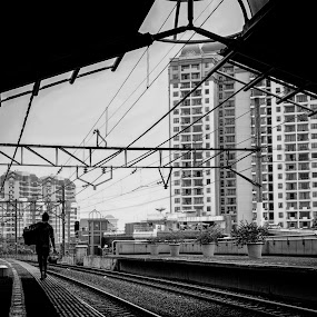 In The Darkest Day by Aditya Kristanto - City,  Street & Park  Street Scenes ( urban, train station, jamu, black and white, station, indonesia, lady, jakarta, sihouette, city street )