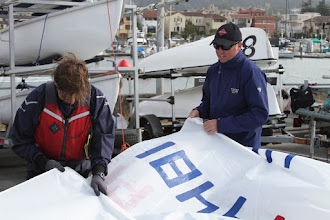 Photo: Removing the batons and packing away the sail.