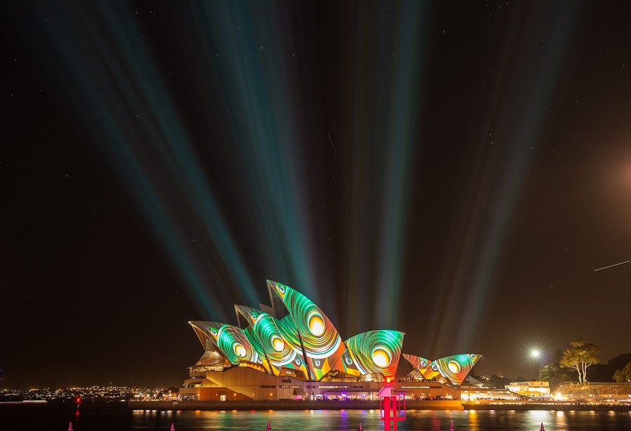 Opera house in Vivid Sydney festival 2013 by Chaiwat Leelakajonkij รักในหลวง - Buildings & Architecture Public & Historical ( pwcarcreflections, australia; sydney; architecture; art; australian; bright; brown; building; celebration; circular; color; colour; creative; cyan; design; editorial; evening; exposure; famous; festival; green; harbor; harbour; house; icon; illuminated; landmark; light; lights; long; new; night; opera; orange; pattern; projection; purple; quay; red; sails; south; spectacular; structure; theatre; tourism; vivid; wales; water; white; yellow, night, lights )
