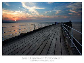 Photo: #SunsetSaturday  Walking on the Pier at Sunset  The West Pier in Whitby on the Yorkshire Coast is a great place for a stroll to admire a summer sunset over the North Sea.  Canon EOS 5D, 17-40mm at 21mm, ISO 50, 1/5s at f20