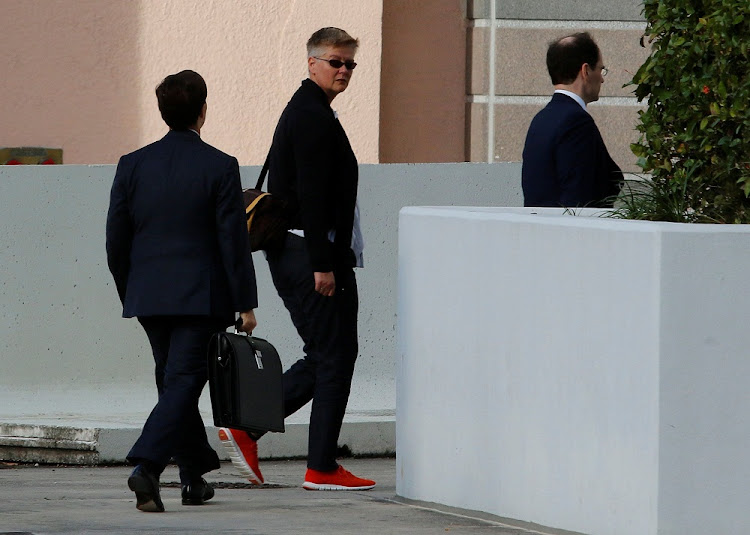 The wife, centre, of Volkswagen executive Oliver Schmidt walks with attorneys after his hearing in federal court in Miami, Florida, US. Picture: REUTERS