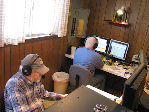 Photo: Bill N4SV (foreground) on 20m SSB and Terry W8ZN on V/UHF FM (background)