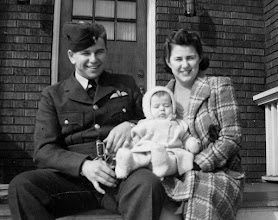 Photo: On his last home leave in February, 1942, he had his picture taken with his sister Kae and his five months old nephew.