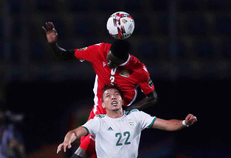 Kenya's Joseph Okumu vies for the ball with Algeria's Ismael Bennacer