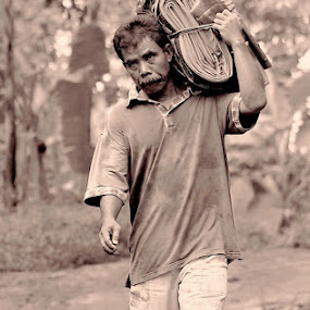 Going To Market by Dody Isnanto - People Portraits of Men