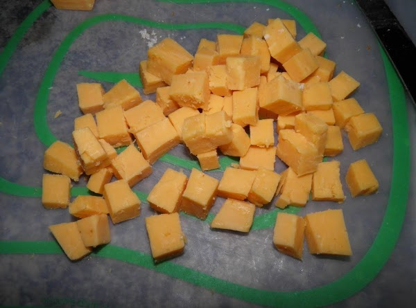 Cut 8oz sharp cheddar cheese into small cubes, or use shredded cheese. Add to...