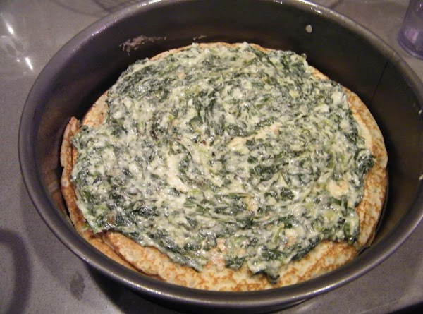 Spinach filling: Cook the shallots in butter for a minute or two in a...
