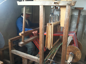 Photo: Jose Luis demonstrates the art of the hand/foot loom.