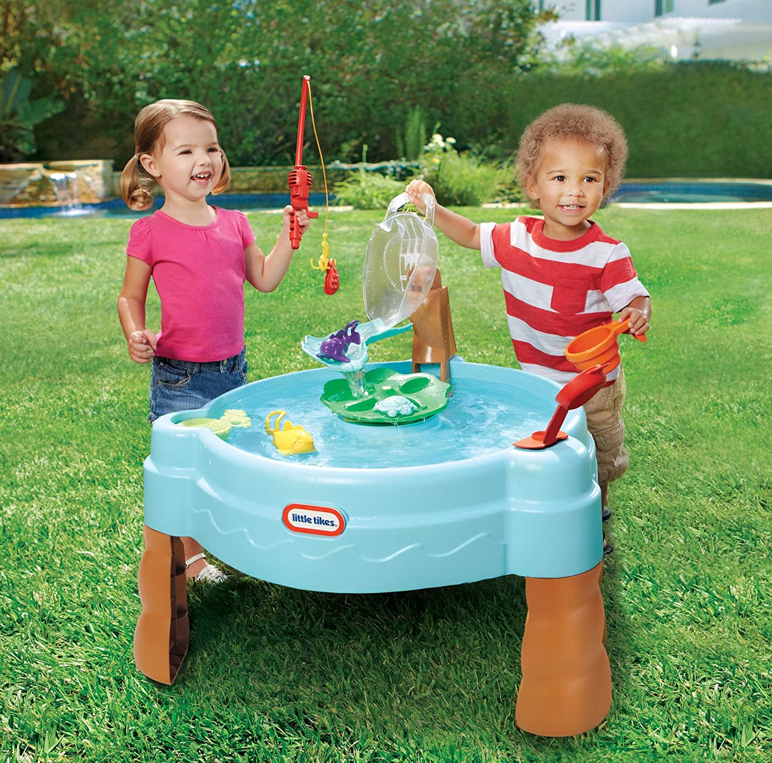 kids playing with water table