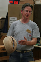 Photo: Duane Schmidt talks about his attempt to stabilize the crack in his natural edge cherry bowl with maple slats.