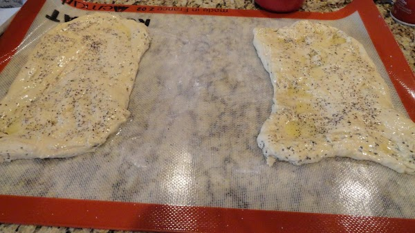 Top each rectangle with melted butter, salt and cracked pepper. Using a pizza cutter...