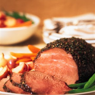 HERB-CRUSTED SIRLOIN TIP ROAST WITH CREAMY HORSERADISH-CHIVE SAUCE.