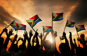 People waving South African flags in the air. 123RF stock image/ rawpixel