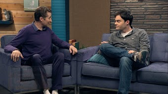 Bill Hader Wears a Grey Button Down Shirt and Sneakers