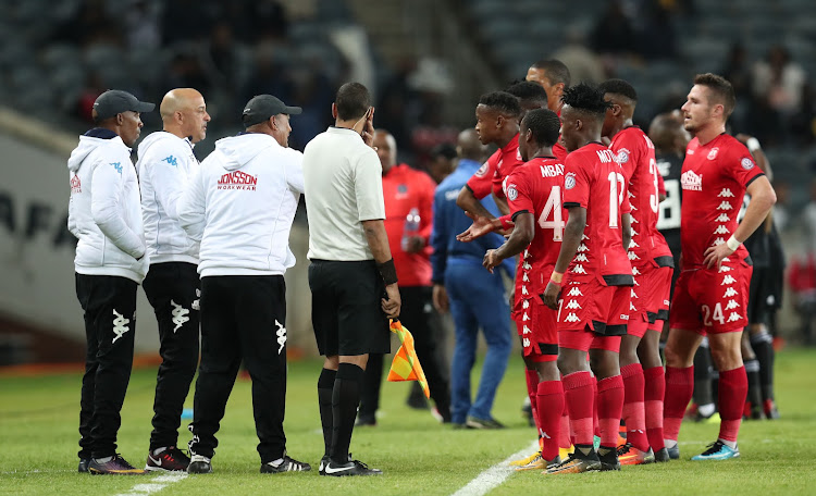 Highlands Parks head coach Owen Da Gama and his assistants chat to the players during a Absa Premiership match against Orlando Pirates at Orlando Stadium on August 4 2018.