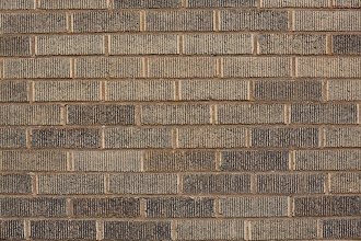 Photo: The classic brick-wall test, 70mm, 1/200 sec., F/8, ISO 500. Vignetting not a problem, but pincushioning. It's pretty sharp across a most of the frame. All tests on Canon 5D Mark III.