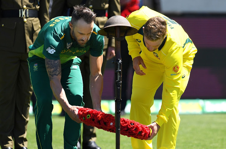 Australia's captain Aaron Finch and South Africa's captain Faf du Plessis (right) lay a wreath during a memorial service to mark Armistice Day before the start of the third one-day international at Bellerive Oval in Hobart, Australia, November 11 2018. Picture: REUTERS/AAP/DEAN LEWINS