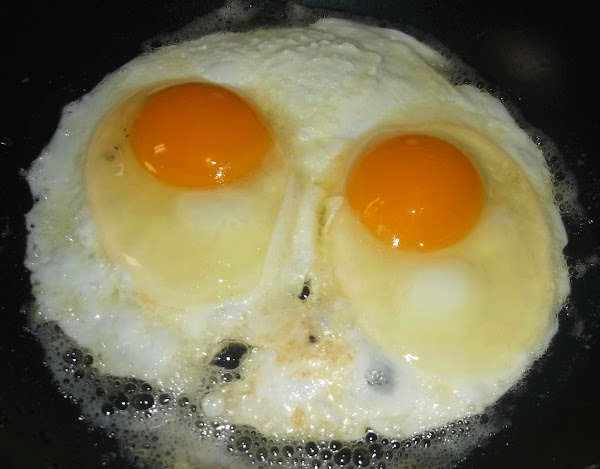 Crack each egg and add to skillet; fry in butter, over medium heat, for...