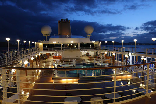 Adonia-Lido-Deck-at-Night.jpg - Stroll the Lido Deck during those warm Caribbean nights on Fathom's Adonia.