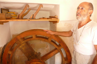 Photo: Amable has restaured the old watermill and is explaining how things work